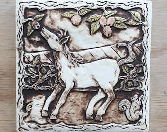 Handmade ceramic tile with a horse, apples and hedgerow for installation or wall hanging