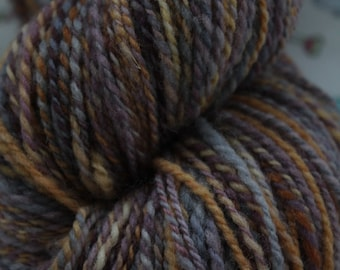 100% pure wool, hand dyed, hand spun. Yarn in a DK weight. 110gms.