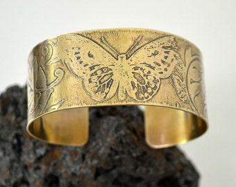 "Etched brass cuff bracelet.  ""butterfly""  can be made smaller"