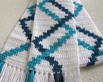 Geometric striped scarf. White crochet scarf with blue diagonal stripes