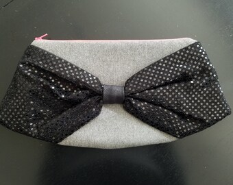 Bow Clutch - Recycled Denim Body, Black Sequin Bow, Multi-Color Floral Lining, Neon Pink Zipper