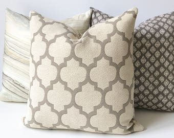 Modern tan and beige moroccan quatrefoil decorative throw pillow cover