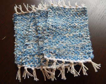Light blue with white accents handwoven set of mug rugs, coasterb tabe mats