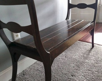 Antique chairs turned into a bench