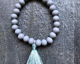 Gray wood and aqua tassel stretch stacking bracelet