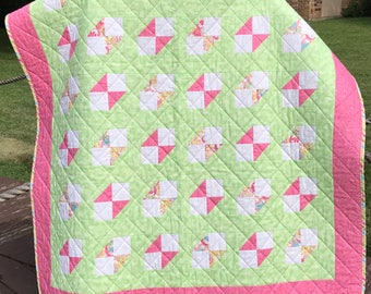 """Confetti Sprinkled Pink and Floral Hearts Fabric Altogether In This 41"""" X 44"""" Butterfly Design Quilt"""