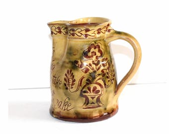 Mary Wondrausch jug.  Mary Wondrausch slipware sgraffito jug. Early Mary Wondrausch, the Wharf Pottery jug. Motto war jug