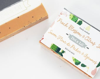 Peach Blossom & Citrus scented vegan soap in coral, white and grey with poppy seeds