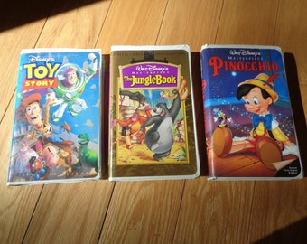 3 Vintage Walt Disney VHS Tapes sold in ONE LOT in the original box packaging in Good Condition, Great Animated Stories for the Family
