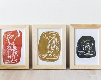 A set of three linocut artprints