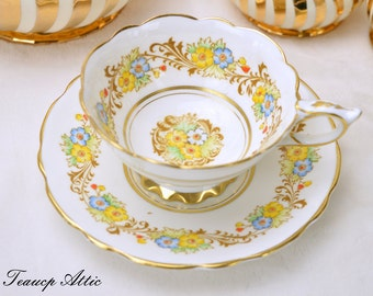 ON SALE Royal Stafford White And Gold Teacup and Saucer With Hand Painted Floral Centers, Vintage English Bone China Tea Cup,  ca. 1950