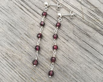 Long ear dangles with small garnets in a chain