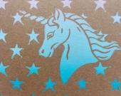 Unicorn card , rainbow pastel linocut card with stars printed on recycled kraft card