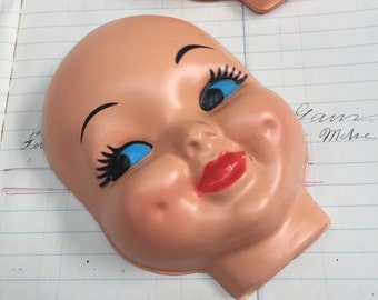 Creepy  baby doll faces - vintage plastic doll head - old kids doll head - strange doll parts - doll oddity - weird doll face