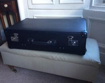 Large blue vintage suitcase
