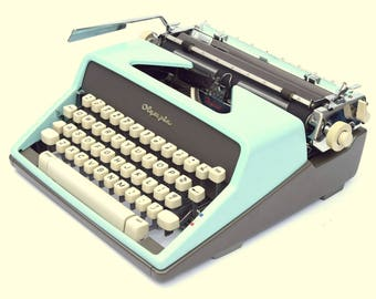 Blue Olympia SM7 De Luxe Typewriter Professionally Refurbished Portable w/New Platen and Two New Ribbons