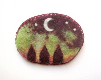 Needle felt brooch, moon with starry sky and little houses.