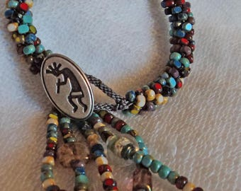 Picasso Kumihimo bracelet with a Kokopelli button