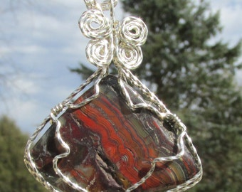 Polished Banded  Jasper,wirewrapped Pendant in Argentium silver wire.