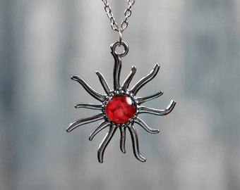 Gunmetal sun shaped 18 inch necklace with red rose photo center.