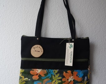 A handmade purse/bag with manually painted flowers