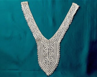 Bodice yoke, vintage.   Very light ecru, hand made, machine lace with a decorative border on a backing of net.  c1920's-30's.