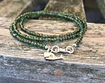 Handmade wrap bracelet with picasso aquamarine green japanese seed beads and a sterling silver whale charm