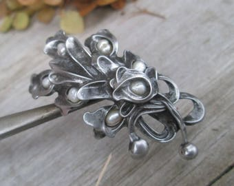metal brooch with pearls