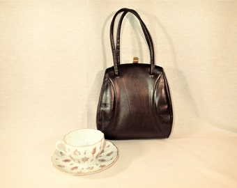 Little Brown Leather purse, CMSVintge handbag. Leather covered metal frame, gold tone clasp, double handle straps