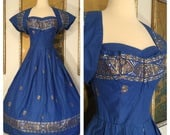 RESERVED -- 1950s Vintage Hawaiian Dress by Peggy Wood Honolulu -- Rich Blue with Metallic Tribal Designs