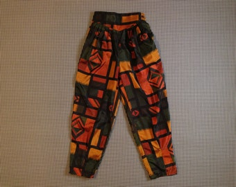 1990's, high waist, pleated front, silk pants, in orange, green, and black, abstract, geometric print