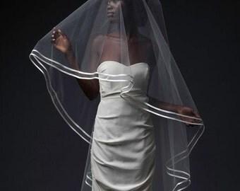 CANDEM VEIL - cascade-cut chapel veil finished with a sleek double bias