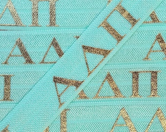 58 aqua with gold alpha delta pi letters fold over elastic