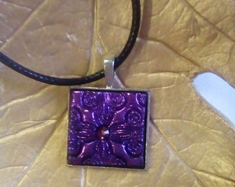 Purple embossed polymer clay pendant in square metal setting