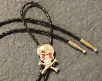 Skull with Rhinestone Eyes Bolo Tie - Black Cord - Silver Finish Tips