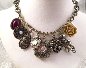 Necklace, brass-tone chain with assorted pendants abd charms