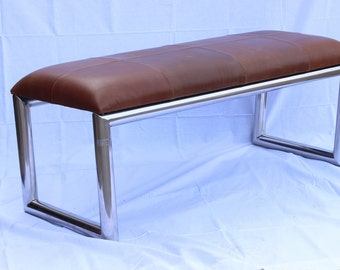 Midcentury bench with saddle leather upholstery and steel base