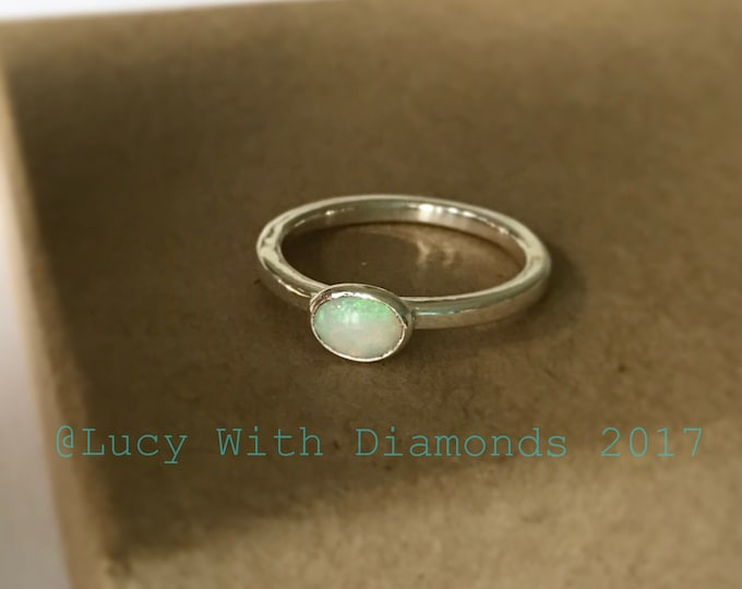 Opal stacking ring with oval opal and polished finish ring