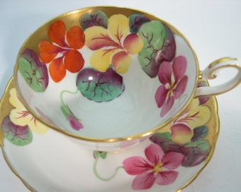 Rare Stunning Tuscan Tea Cup And Saucer , Hand Painted Flowers and Gold trim.