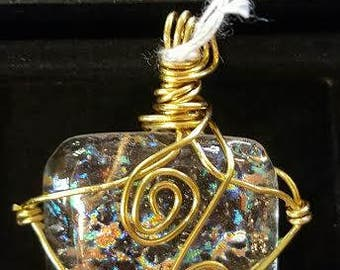 Clear dichroic glass with gold sparkles. Wire wrapped gold