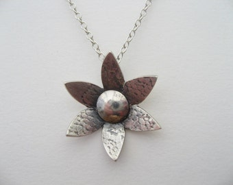 Flower pendant necklace in lace textured sterling silver