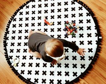 Round baby playmat, monochrome, swiss cross modern nursery, crawling mat. Nursery rug. Black and white decoration.