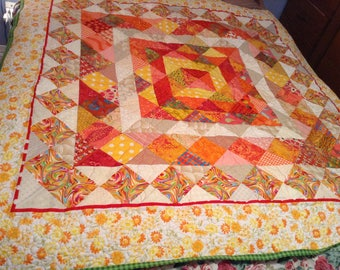 "Beautiful sunshine quilt, orange, yellow, red, approx 64x64"", one hundred percent cotton fabric and batting"