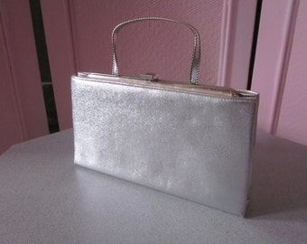 "1960s Silver Metallic Vinyl Clutch by ""Ande"""