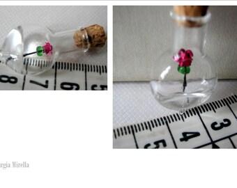 rose flower in bottle miniature