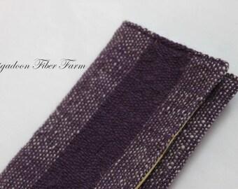 Hand woven clutch , 1 pocket, silk brocade lining, wool shell, purple, cream, yellow.