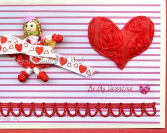 VALENTINE CARD - HAND Made; miniature doll, removable, soft heart, ribbon, scrapbooking items, red envelope, 5 x 7 inches approximately