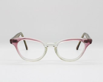 1950s cat eye spectacles. Original clear lens frames in pink, brown, see through. Vintage optical eyeglasses. Cateye