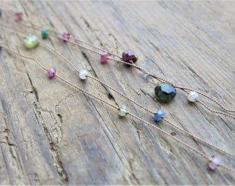 Long tourmaline necklace. Minimalist tourmaline necklace on a light brown silk thread.