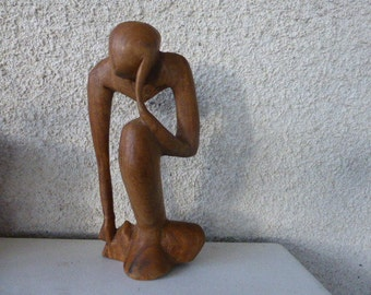 Statue, wooden sculptor the thinker, design and original